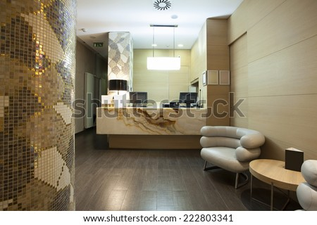 Reception area with marble reception desk - stock photo