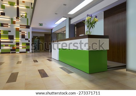 Reception area with reception desk - stock photo