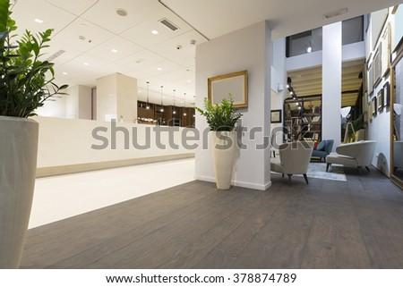 Reception area with reception desk - stock photo