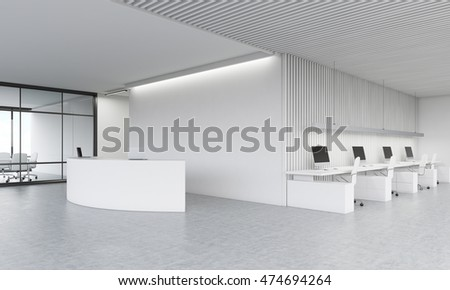Reception desk in lobby meeting room and office area in background concept of modern