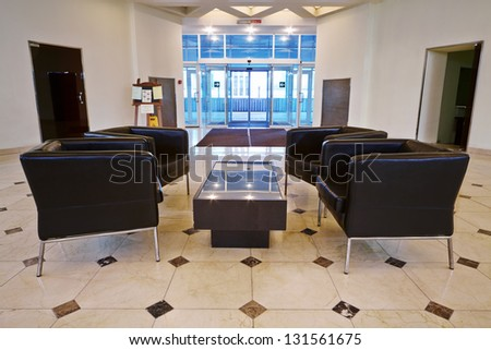 Reception hall with leather armchairs in business center