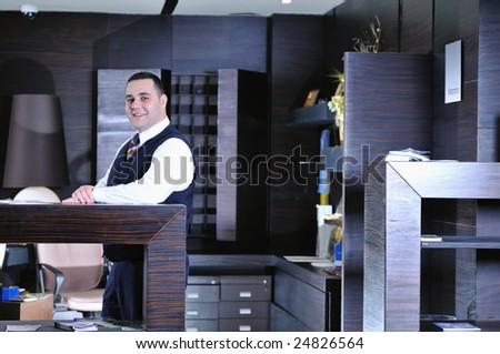 reception service man hotel indoor smile travel - stock photo