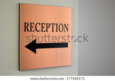 Reception sign with direction arrow. - stock photo