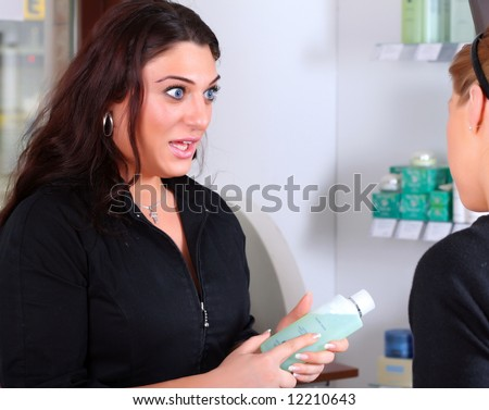 Receptionist talking with a customer - stock photo