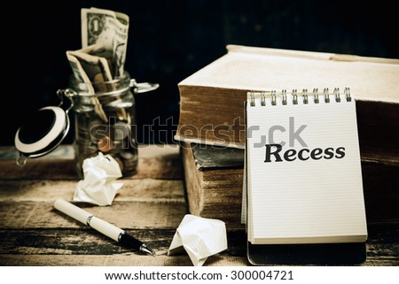 Recess word book on wood table vertical  - stock photo