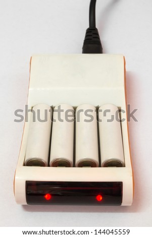Rechargeable battery and battery charger - stock photo