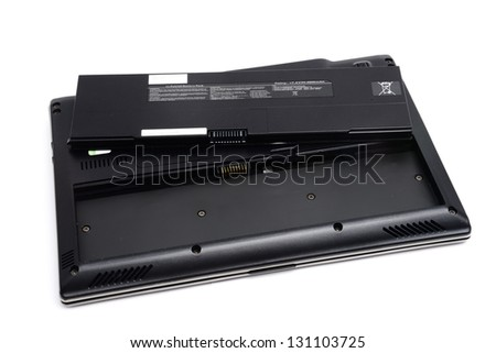 Rechargeable battery and laptop computer - stock photo