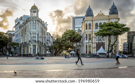 RECIFE, BRAZIL, APRIL 12: Panoramic view of the architecture of Marco Zero Square in Recife Antigo, Pernambuco, Brazil at sunset with some locals and tourists enjoying themselves on April 12, 2014. - stock photo