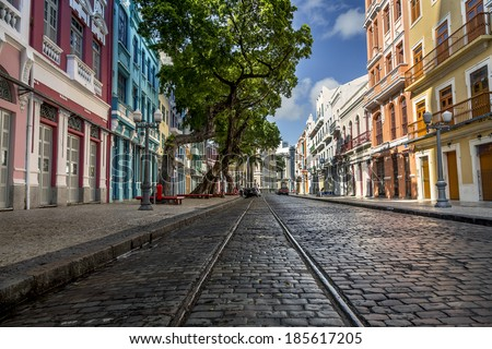 RECIFE, BRAZIL - MARCH 30: Panoramic view of the sixteen-century architecture of Bom Jesus Street's buildings and its cobble stones in Recife Pernambuco, Brazil on March 30, 2014. - stock photo