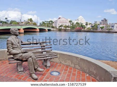 RECIFE - MAY 31: View of Joao Cabral de Melo Neto statue and Capibaribe river on May 11 2013 in Recife. He is considered one of the great poets of Brazilian literature. - stock photo