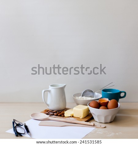 recipe and baking ingredients with glasses - stock photo