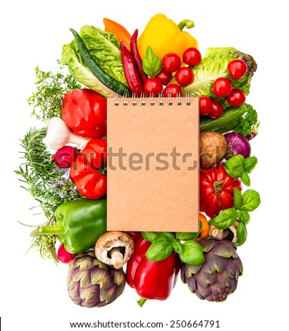 recipe book with fresh organic vegetables and herbs isolated on white background. healthy food ingredients - stock photo