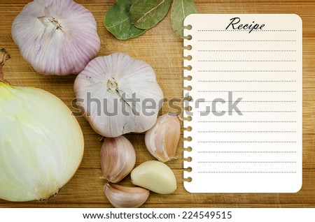 Recipe card template on wooden cutting board with vegetables - stock photo