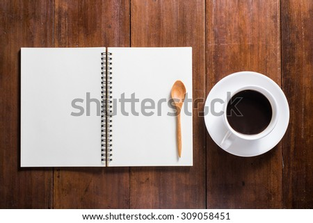 Recipe notebook, Coffee cup top view on wooden table