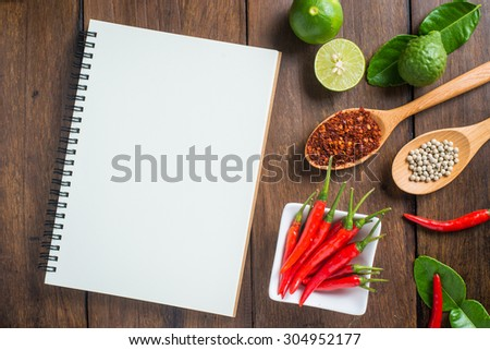 Recipe notebook rice red chilli garlic stock photo royalty free recipe notebook rice red chilli garlic and lemon on wood texture background forumfinder Image collections