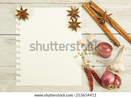 Recipe paper and row materials on white wooden table. - stock photo