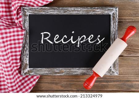 Recipes written on chalkboard, close-up - stock photo
