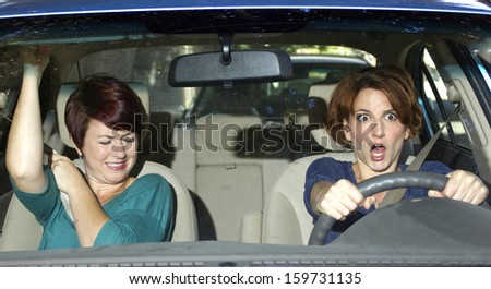 reckless driver and scared female passenger in a car