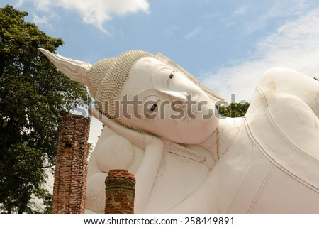 Recline buddha statue - stock photo