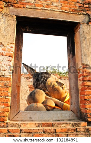 Reclining Buddha and frame from window , Historical Park Ayutthaya, Thailand - stock photo
