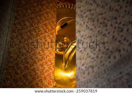 Reclining Buddha Gold Statue at Wat Pho, Bangkok, Thailand - stock photo