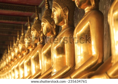Reclining Buddha gold statue ,Bangkok, Thailand - stock photo