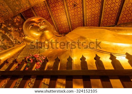 Reclining buddha image in  famous temple - stock photo