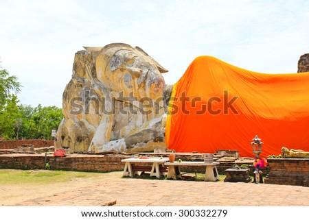 Reclining Buddha of Wat Lokaya Sutha in Ayutthaya, Thailand. - stock photo