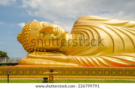 Reclining Buddha statue - stock photo