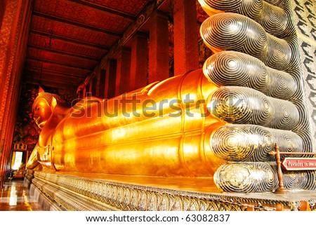 Reclining Buddha statue in Thailand Buddha Temple Wat Pho , Asian style Buddha Art - stock photo