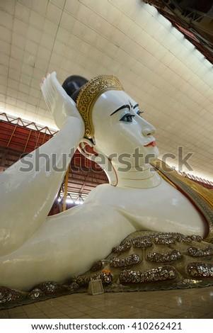 reclining buddha with big eye in yangon - stock photo