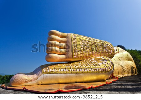 Reclining Golden Buddha in North of Thailand - stock photo