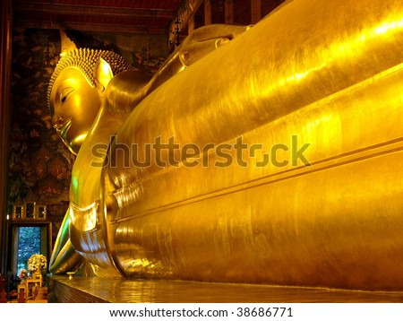 Reclining golen buddha - stock photo