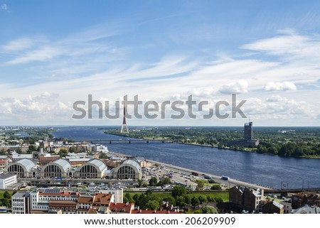 Recomposed view of Riga, Latvia. Taken from the top of St Peters Church, looking towards the Market, river and TV tower.
