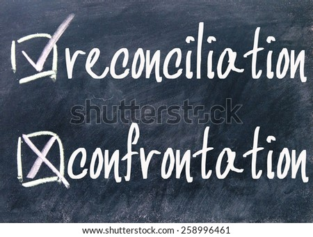 reconciliation and confrontation choice sign on blackboard