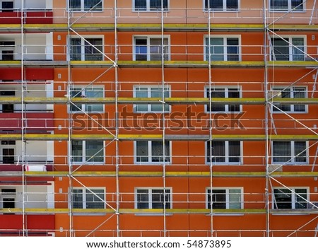 Reconstructed and painted flame-colored building - stock photo
