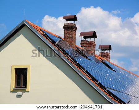 Reconstructed house with solar panels on the roof. - stock photo