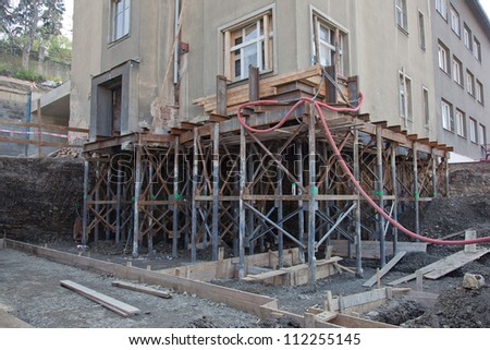 Reconstruction of the building and makinh new foundation - stock photo
