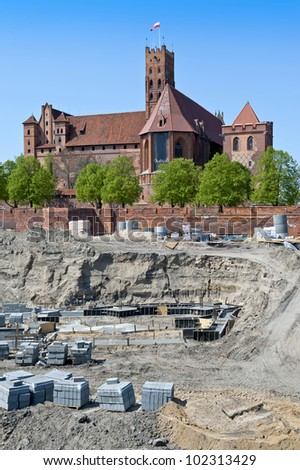 Reconstruction of the medieval Teutonic Knights' fortress in Malbork, Poland. - stock photo