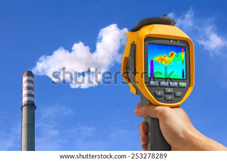 Record heat emission at the Chimney of energy station with infrared thermal cameras  - stock photo