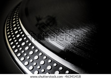 record on turntable - stock photo