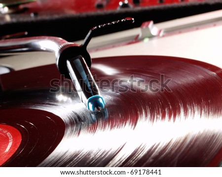 Record player spinning and vinyl disc . - stock photo