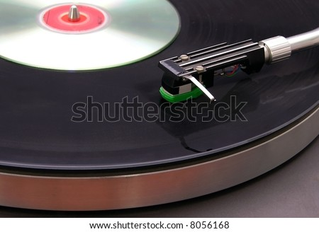 Record Player with CD on top in a club