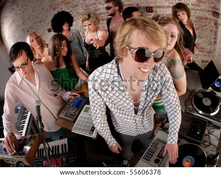 Record spinning men at a 1970s Disco Music Party - stock photo