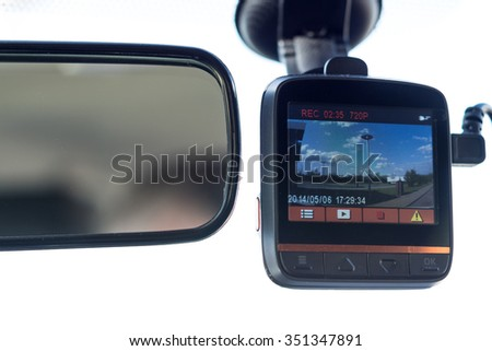 recording car camera on the front window - stock photo