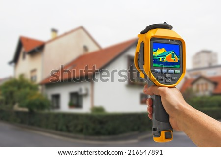 Recording Heat Loss at the House With Infrared Thermal Camera - stock photo