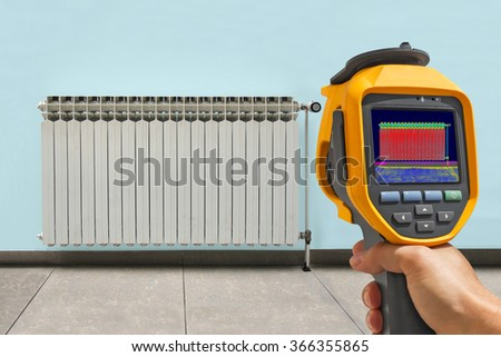 Recording Radiator Heater with Infrared Thermal Camera - stock photo