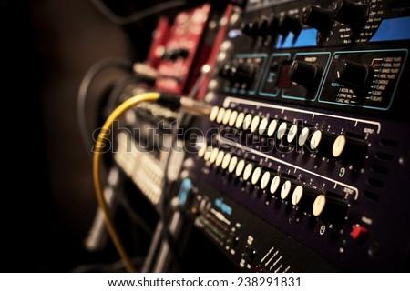 recording studio gears in rack, focus to knob & shallow dept of field - stock photo