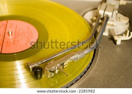 recordplayer with yellow lp records (33 1/3 rpm) - stock photo