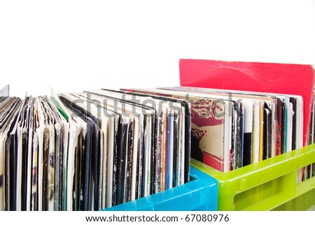 Records in plastic boxes on white, closeup - stock photo